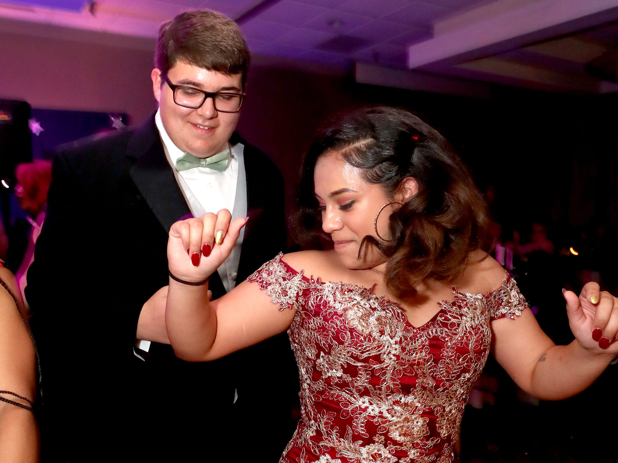 Nate Steinhurst, left and Elizabeth Perez, right  dance on the dance floor at Holloway's prom at the DoubleTree on Thursday April 18, 2019.