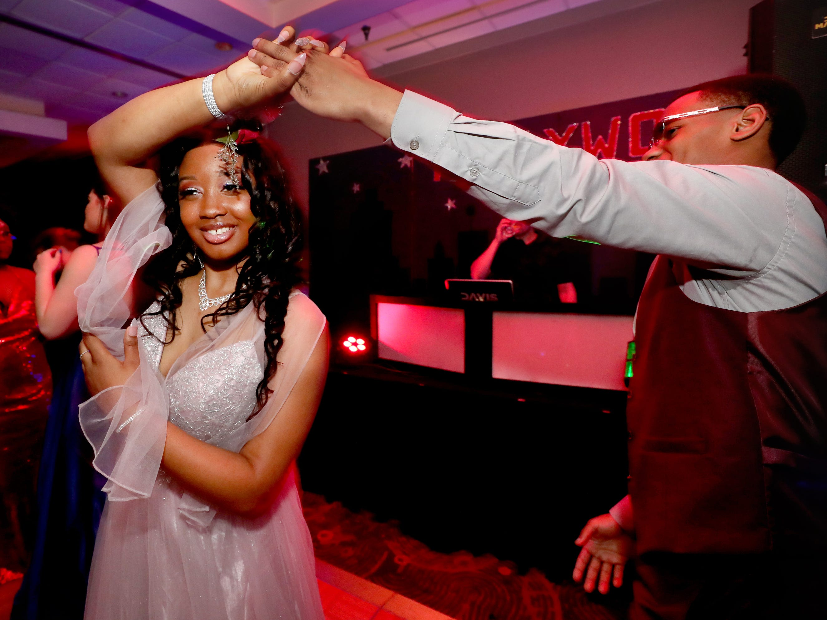 Aalijah Daniel, right spins Antoinette Sherrell, left, on the dance floor during a slow dance during Holloway's prom at the DoubleTree on Thursday April 18, 2019.