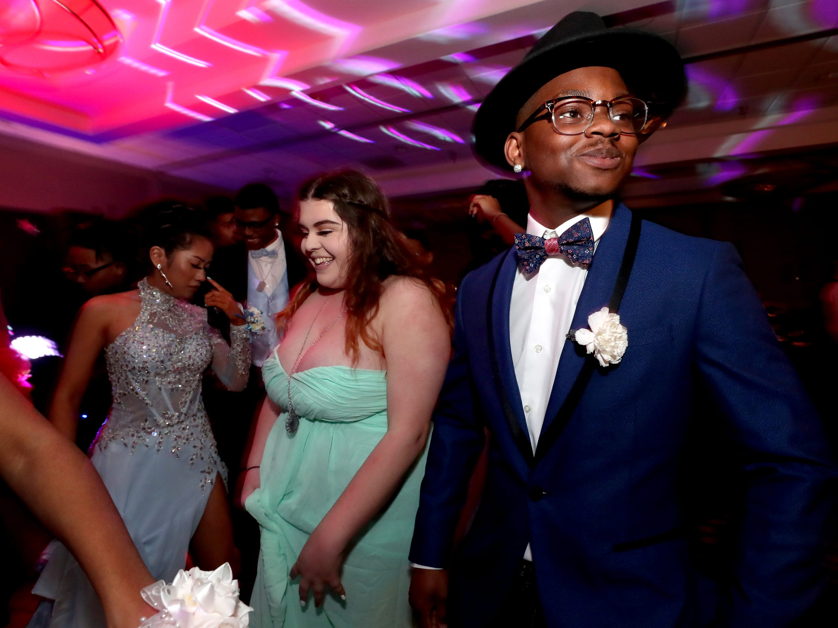 Somer Davis, left and Ahmir Gray, right dance at Holloway's prom at the DoubleTree on Thursday April 18, 2019.