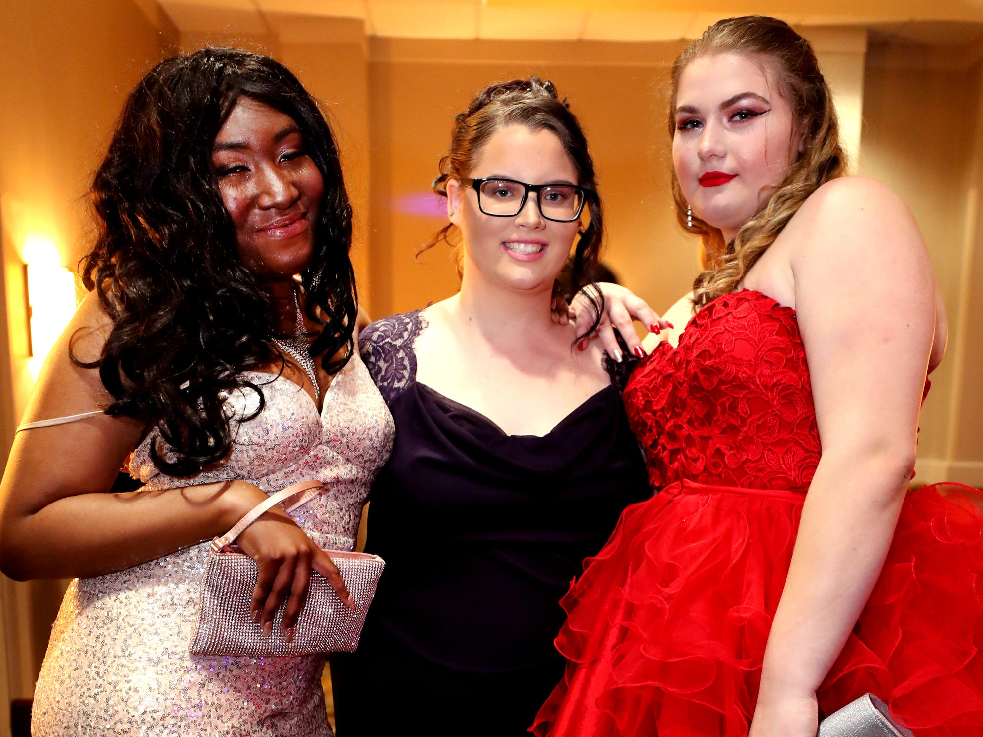 Simya Pennington, left, Destiny Fenner, center, and Cortney Springer, right at Holloway's prom at the DoubleTree on Thursday April 18, 2019.