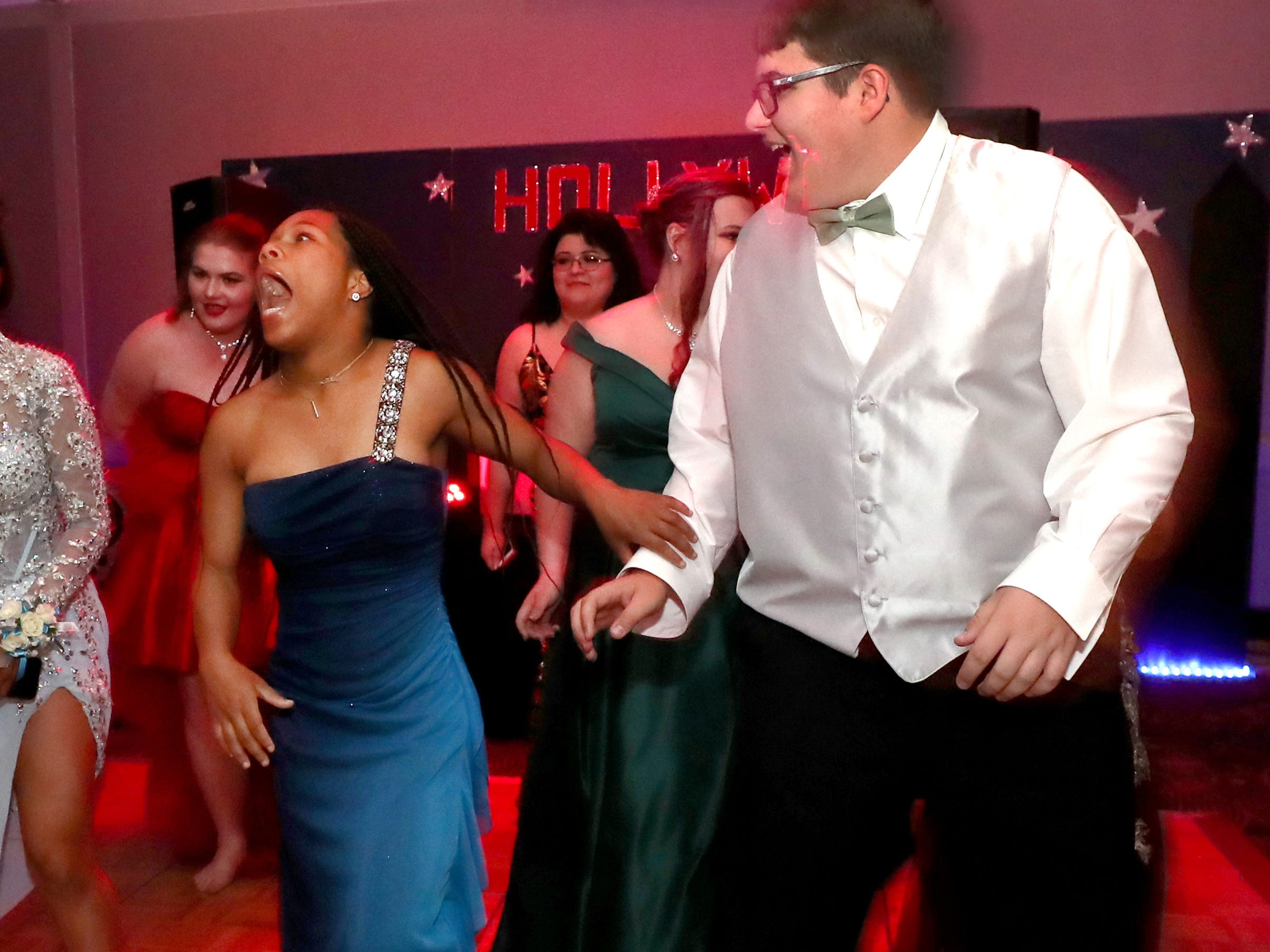Tiara Lewis, left, and Nate Steinhurst, right dance on the dance floor at Holloway's prom at the DoubleTree on Thursday April 18, 2019.