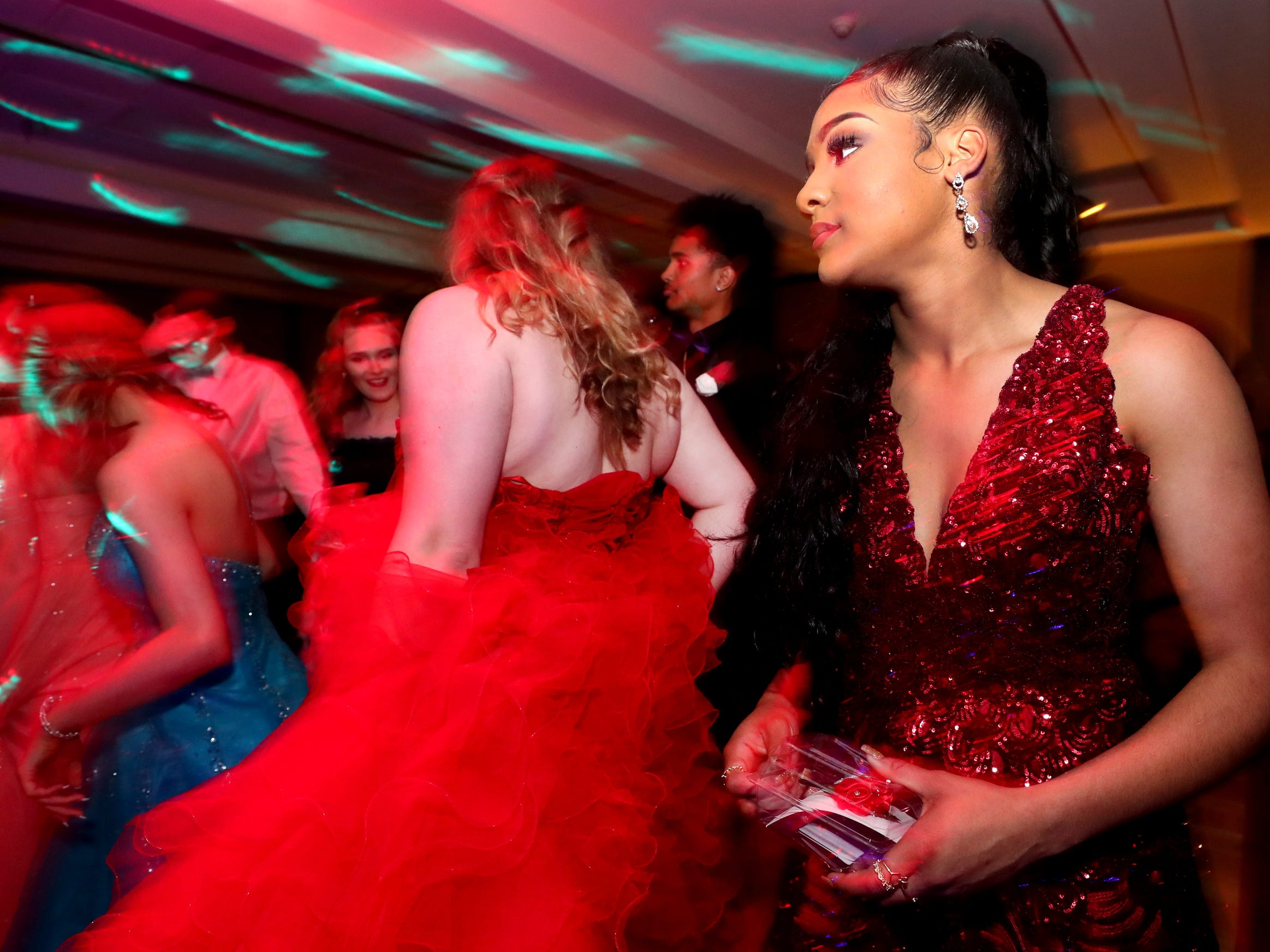 Shelby Utley dances on the dance floor at Holloway's prom at the DoubleTree on Thursday April 18, 2019.