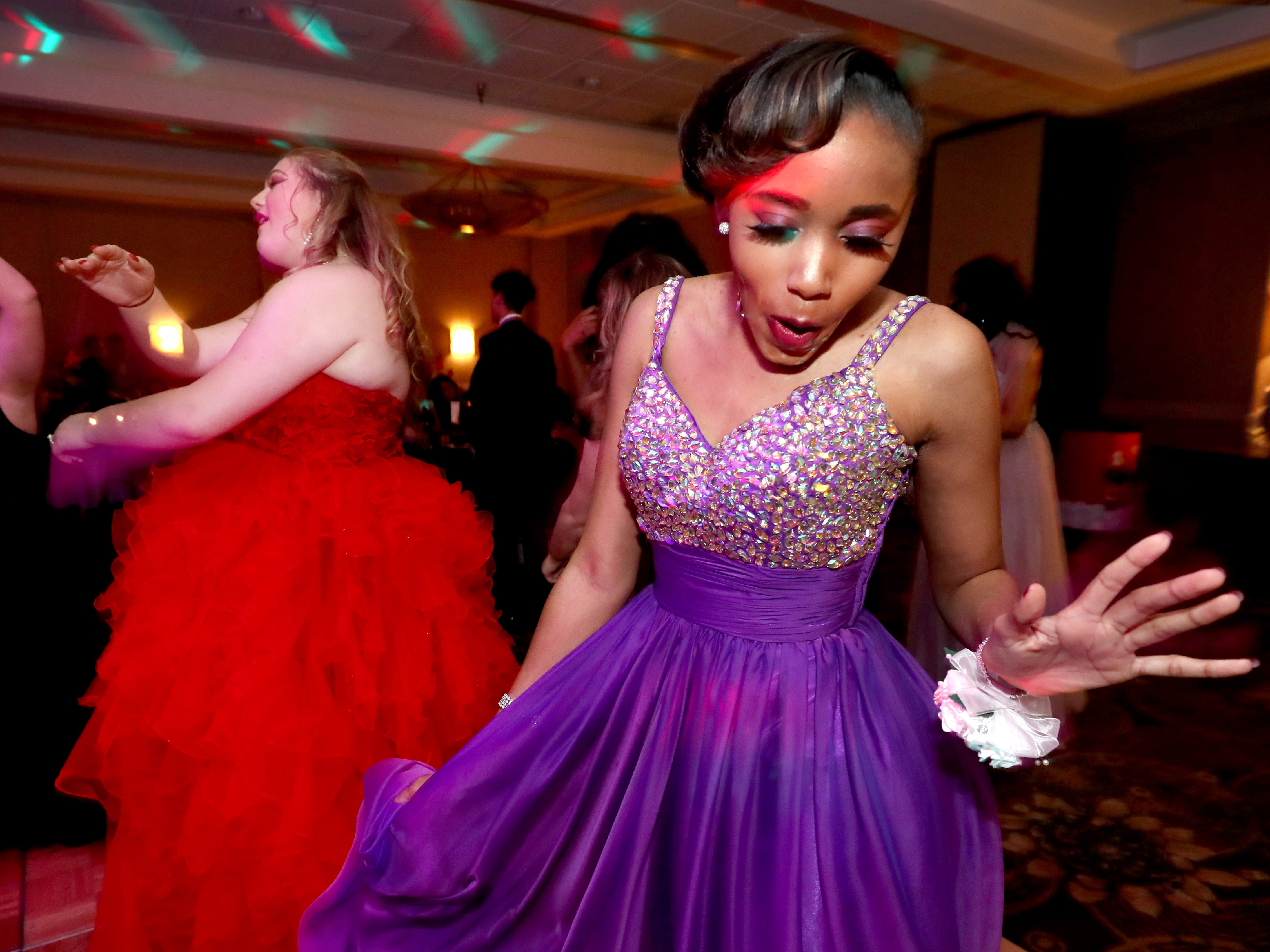 Tara Lewis dances on the dance floor at Holloway's prom at the DoubleTree on Thursday April 18, 2019.