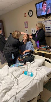 Mackenzie Schindler gets her hair and makeup done by Brittanie Wood, behind, and Tabatha Whitlow at Sumner Regional Medical Center in Gallatin.