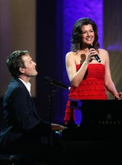 Michael W. Smith and Amy Grant perform together during the GMA Dove Awards show at the Grand Ole Opry House on April 23, 2008.