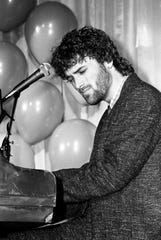 """Contemporary Christian artist Michael W. Smith performs """"Once in a Lifetime Love"""" during ASCAP's seventh annual Gospel Music Week luncheon at the Radisson Plaza Hotel on April 1, 1985."""