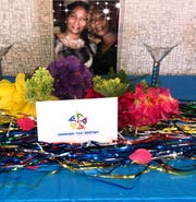 A family photo of Blanche Harris Spikes' two sisters, Pam Taylor and Chanda Petties, taken before their deaths in January 2014, was displayed during the first event organized by Celebrate Your Siblings earlier this month.