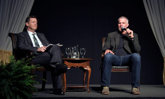NFL Hall of Fame quarterback Brett Favre, right, talks with Middle Tennessee Christian president Matt Tiller during the school's Legacy of Light Gala Thursday.