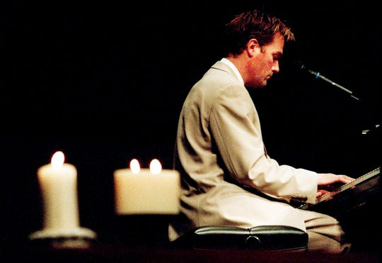 """Michael W. Smith performed several songs and talked about his trip to Littleton, Colo., during a communitywide memorial service for victims of the Columbine High School massacre at People's Church in Franklin on April 27, 1999. About 1,200 people attended the """"Candles of Hope: A Message of Hope from Franklin to Littleton"""" service."""