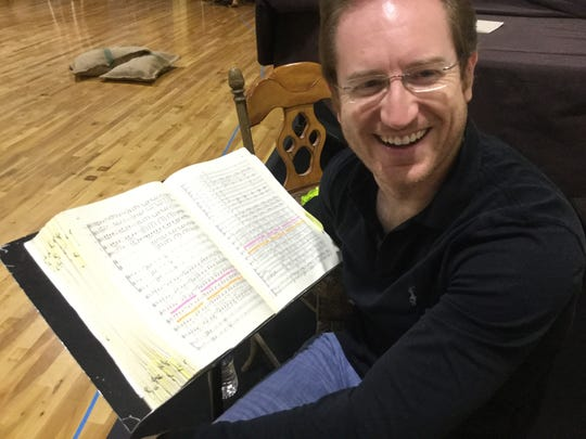 "Opera Naples Artistic Director Ramon Tebar with his marked up  ""Carmen"" score."