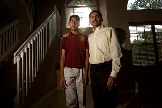 Bharath Ram, left, poses for a portrait with his dad, Ram Kumar, Friday, April 19, 2019 at their home in North Naples.