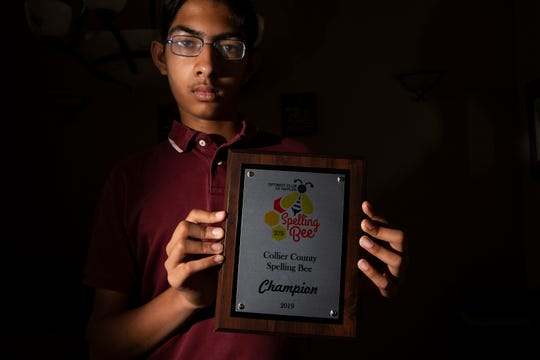 Oakridge Middle School eighth-grader Bharath Ram, 14,  holds his 2019 Collier County Spelling Bee championship plaque, Friday, April 19, 2019 in North Naples. It was the second time Ram won the county spelling bee and it was his second time competing in the Scripps National Spelling Bee starting on Sunday, May 26, 2019.