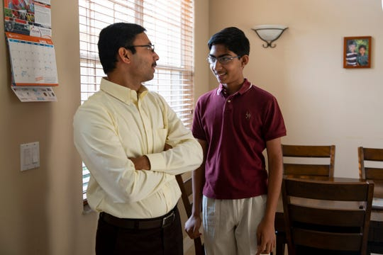 Ram Kumar, left, talks with his son Bharath Ram, Friday, April 19, 2019 at their home in North Naples.