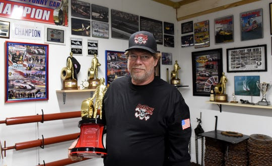 Steve Prince a trophy for the 2018 National Hot Rod Association funny cap championship. Prince grew up around racing and has worked with teams from coast-to-coast.