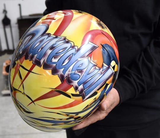 A helmet painted by Steve Prince in display in his Hebron garage.
