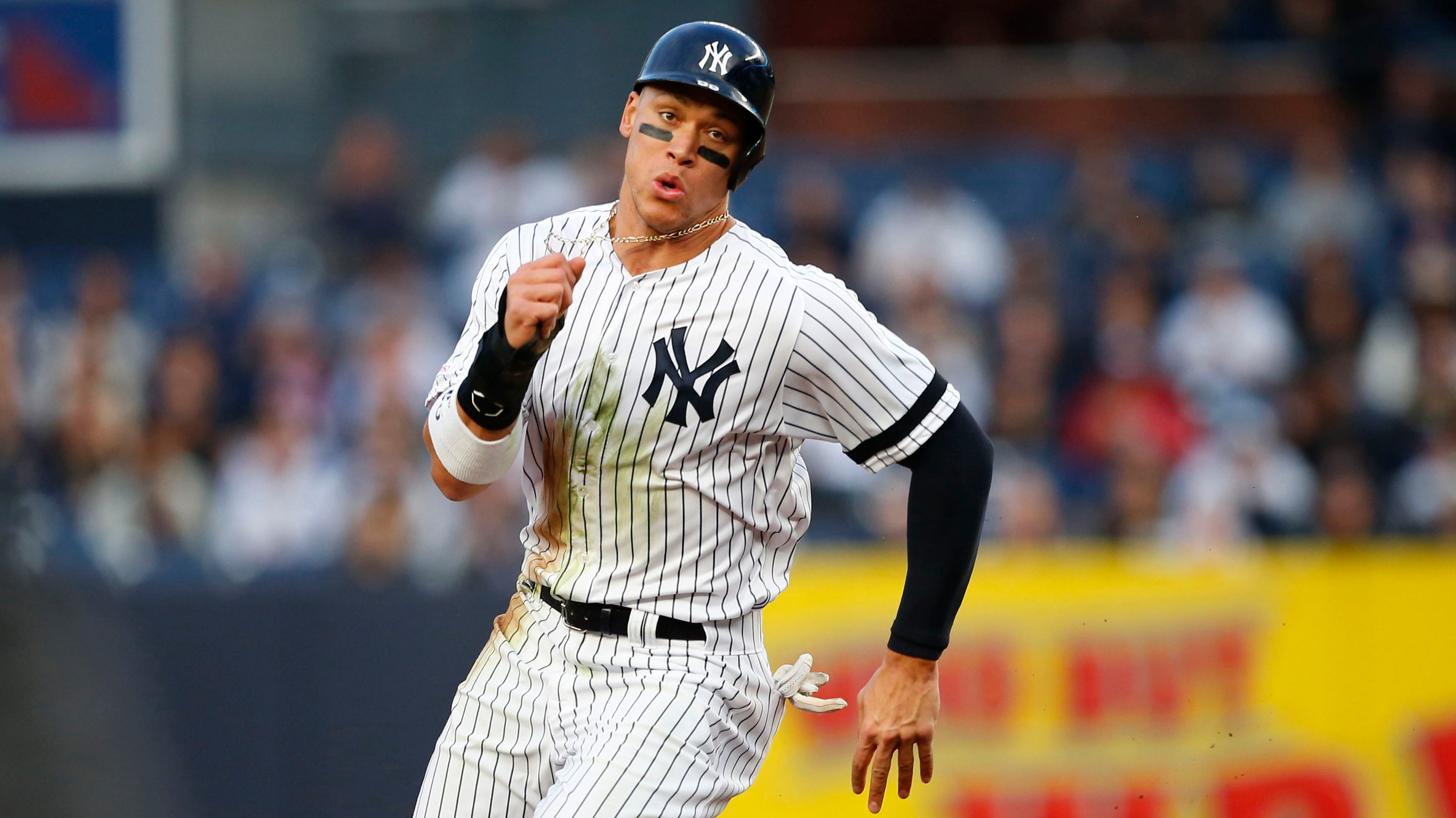 Apr 18, 2019; Bronx, NY, USA; New York Yankees right fielder Aaron Judge (99) runs to third base during the first inning against the Kansas City Royals at Yankee Stadium.