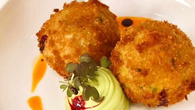 Pan-seared potato latkes at Green Fusion, a new...