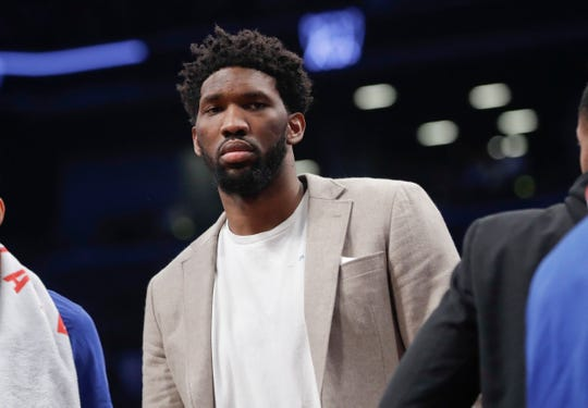 Philadelphia 76ers' Joel Embiid watches during the first half in Game 3 of the team's first-round NBA basketball playoff series against the Brooklyn Nets on Thursday, April 18, 2019, in New York.