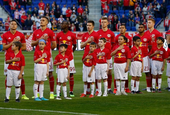 Apr 6, 2019; Harrison, NJ, USA; New York Red Bulls players and mascots during the national anthem at Red Bull Arena.