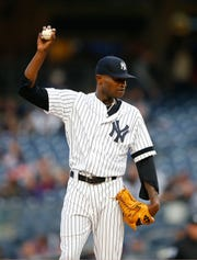 Apr 18, 2019; Bronx, NY, USA;  New York Yankees pitcher Domingo German (55)  pauses before pitching in the first inning against the Kansas City Royals at Yankee Stadium.