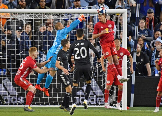 New York Red Bulls goal keeper Luis Robles (31) stretching to make a save during the second half against Sporting KC at Children's Mercy Park on Sunday, April 14, 2019. On Thursday, Major League Soccer's Board of Governors formally unveiled plans Thursday to expand to 30 teams.