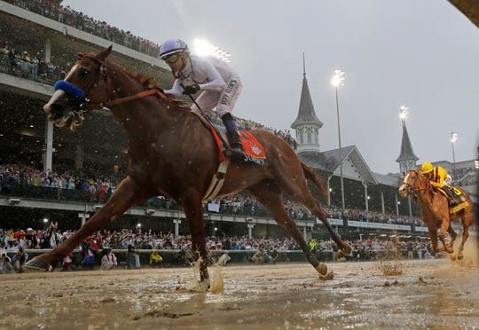 FILE - In this May 5, 2018, file photo, Mike Smith rides Justify to victory during the 144th running of the Kentucky Derby horse race at Churchill Downs in Louisville, Ky.  All three sites of the Triple Crown are among several major tracks that have agreed to phase out the use of a common anti-bleeding medication starting next year. Starting in 2020, 2-year-old horses won't be allowed to be treated with the drug Lasix within 24 hours of racing.