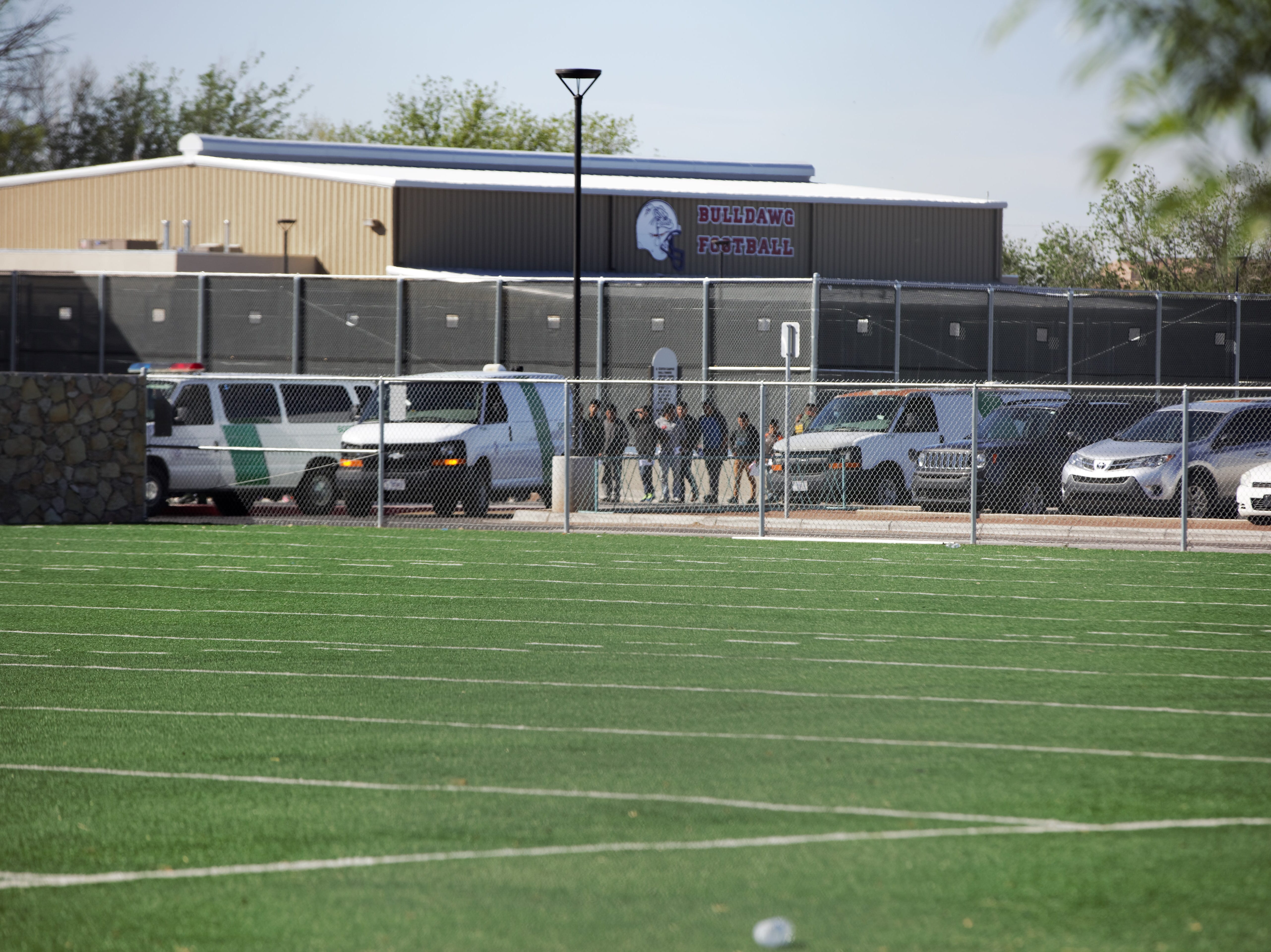 At approximately 9:15 a.m. on Friday, April 19, 2019, at least four U.S. Border Patrol vans were observed dropping off migrants at Las Cruces High School's athletic facility, where they are expected to remain until Monday. Las Cruces Public Schools are on spring break until Tuesday, April 23.