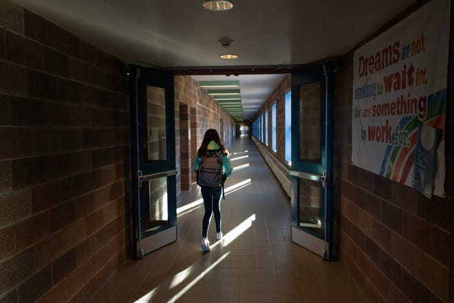 Faith Cisneros is a seventh grader in the Questa school district. She has a rare seizure-inducing condition that requires a daily routine of medications.