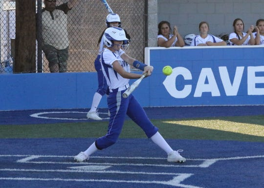 Carlsbad's Jessica Munro connects witha   pitch during Game 1 of Thursday's doubleheader against Roswell. The Cavegirls won Game 1, 9-2 and Game 2, 11-0.