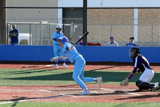 Carlsbad's Mason Estrada watches his hit go to the outfield during Game 1 of Thursday's doubleheader against Clovis. Carlsbad won Game 1, 15-5 and Game 2, 9-0.