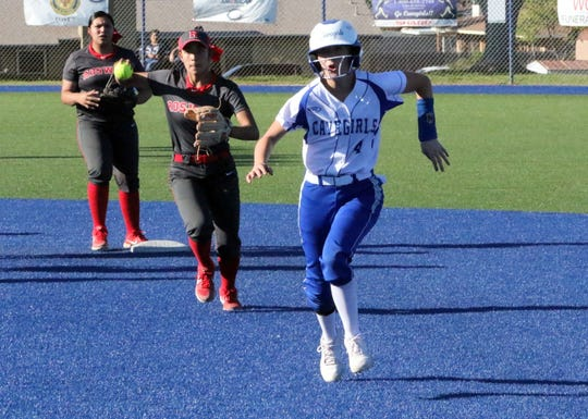 Carlsbad's Jessica Munro successfully escapes a rundown during Game 1 of Thursday's doubleheader against Roswell. Munro forced a throwing error and ended up on second base. She would score later in the inning.