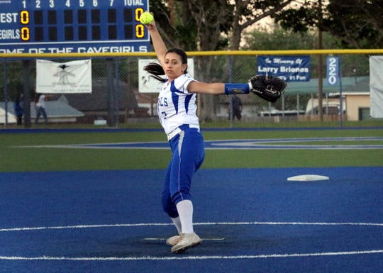 Carlsbad's Ashley Hernandez pitches in the second inning of Thursday's Game 2 against Roswell. Hernandez struck out six batters en route to a five-inning perfect game for the Cavegirls.