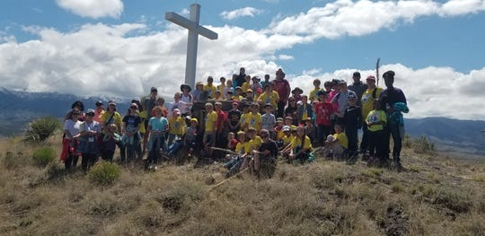 Students, parents and faculty from St. Frances Cabrini Catholic School in Alamogordo at the cross at Santo Niño de Atocha Stations of the Cross at Three Rivers Thursday.