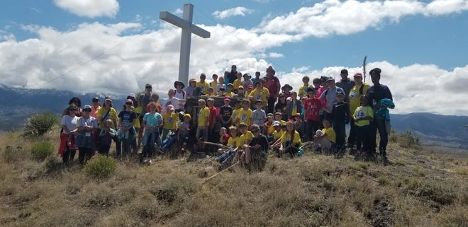Students, parents and faculty from St. Frances Cabrini Catholic School in Alamogordo at the cross at Santo Niño de Atocha Stations of the Cross at Three Rivers in 2019.