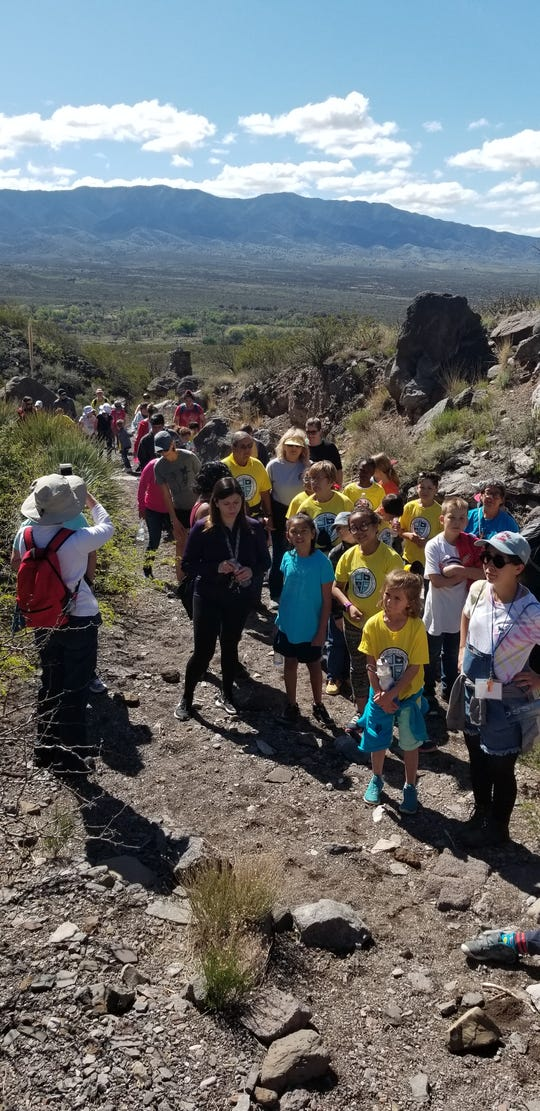 Students, parents and faculty from St. Frances Cabrini Catholic School in Alamogordo hike up to the Santo Niño de Atocha Stations of the Cross at Three Rivers Thursday.
