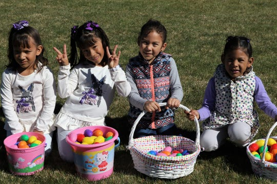 Solpaloma Villarreal, Yanire Villarreal, Kassandra Gordillo and Yaretzi Gordillo sit with their baskets of Easter eggs, Friday, April 19, 2019, during Easter EGGStravaganza at Sycamore Park.