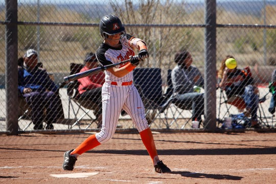Aztec's Shantell Evans makes contact at the plate against Shiprock during Thursday's game at the Aztec Tiger Sports Complex.