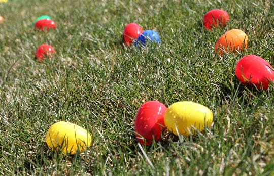 Easter eggs are scattered across the field, Friday, April 19, 2019, during  Easter EGGStravagnza at Sycamore Park.