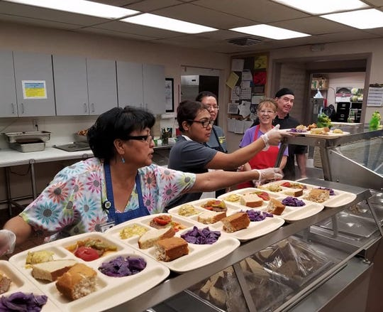 Project SEARCH interns learn to serve food in September at Bonnie Dallas Senior Center.