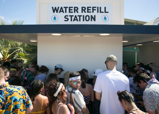 Festival goers gather in line at a water refill station at the Coachella Valley Music and Arts Festival in Indio, Calif. on April 19, 2019.