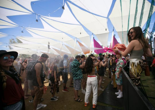 Rachel Savord sprays a crowd in the Dolab tent with water at the Coachella Valley Music and Arts Festival in Indio, Calif. on April 19, 2019.