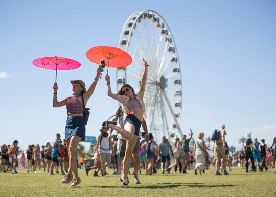 Festival goers walk the grounds at the Coachella Valley Music and Arts Festival in Indio, Calif. on April 19, 2019.