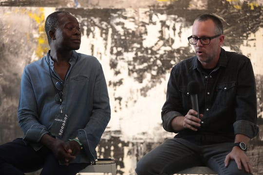 Francis Kéré and Phillip K. Smith III speak on a panel about art and public space at the Mobius 2019 conference in Palm Desert, Calif., April, 18, 2019.