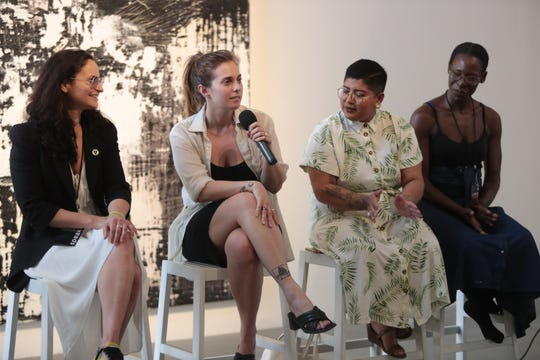 From left, Rain Phoenix, Meg Remy, Sonia Guiñansaca, and Mecca Vazie Andrews speak on a panel about art and activism at the Mobius 2019 conference in Palm Desert, Calif., April, 18, 2019.