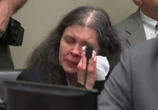 In this screenshot from the AP courtroom livestream, Louise Turpin, 50, wipes away tears as one of her children describes to a judge how the family lived. Turpin and her husband, David, were sentenced to life in prison on April 19, 2019, in Riverside, Calif.