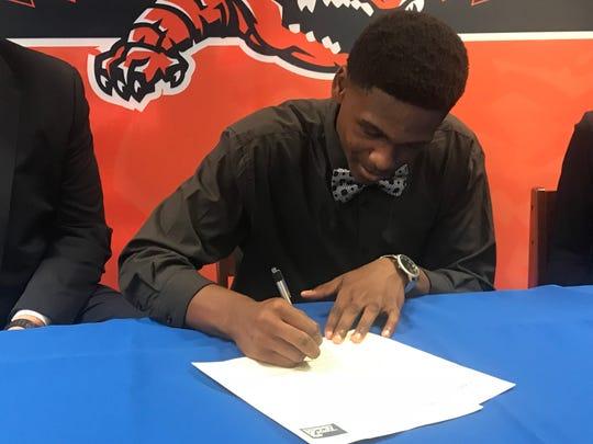Josh Alexander signs with Pensacola Christian College basketball.
