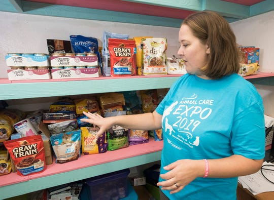 Brandi Winkleman, president of A HOPE for Santa Rosa County, talks Friday about the items the organization offers families through its pet food pantry in Milton.