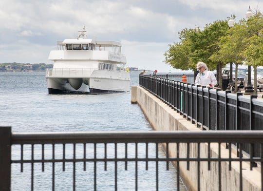 The Pelican Perch ferry boat departs the downtown Commendencia Street landing as ferry service resumes in Pensacola on Friday.
