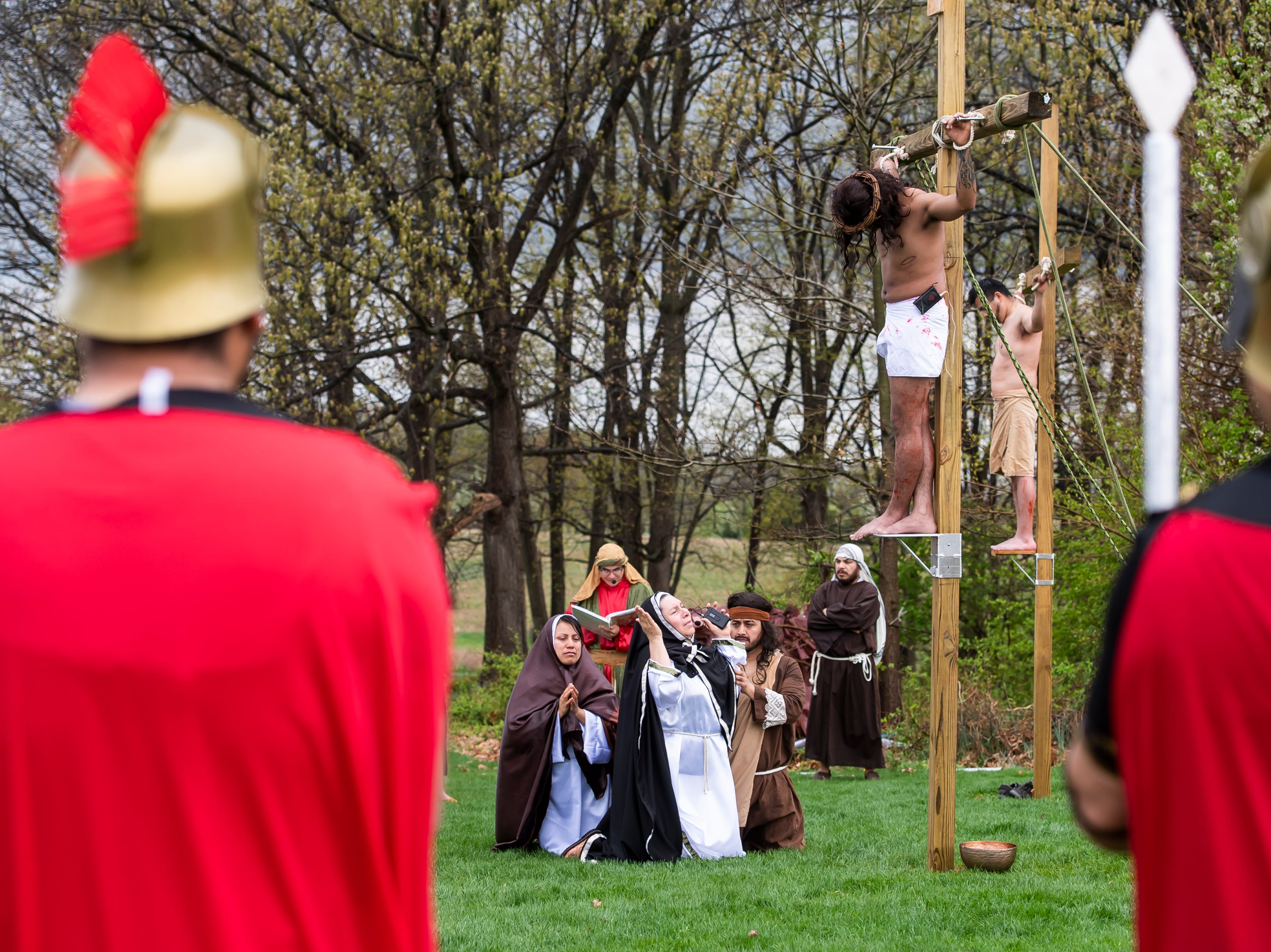 Parishioners at St. Joseph Catholic Church in Hanover take part in a Stations of the Cross procession on Good Friday, April 19, 2019.