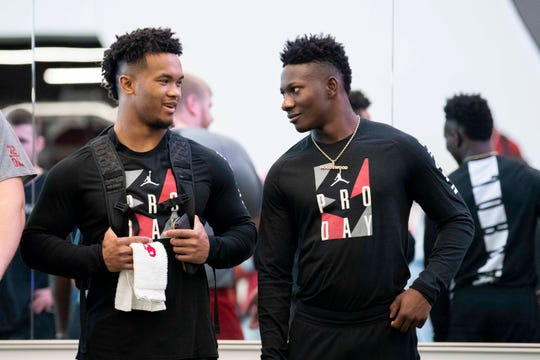 Could the Arizona Cardinals select Oklahoma quarterback Kyler Murray (left) and Sooners wide receiver Marquise Brown (right) with their first two picks in the 2019 NFL draft?